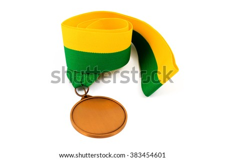 Gold medal on white background with blank face for text, Gold medal in the foreground on yellow green ribbon. - stock photo