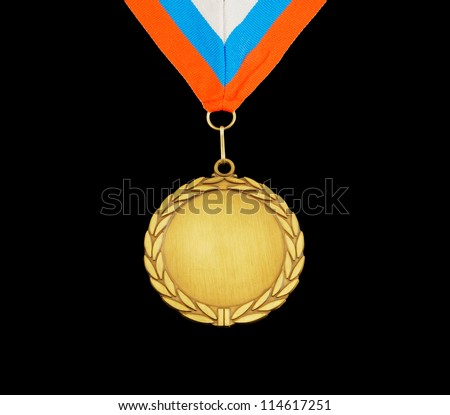Gold medal with ribbon isolated on black - stock photo
