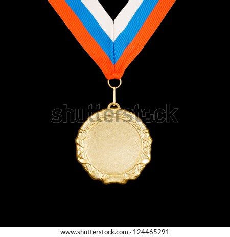 Gold medal with ribbon isolated on black