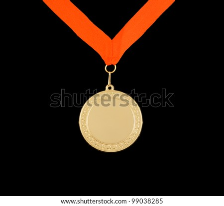 Gold medal with stars isolated on black
