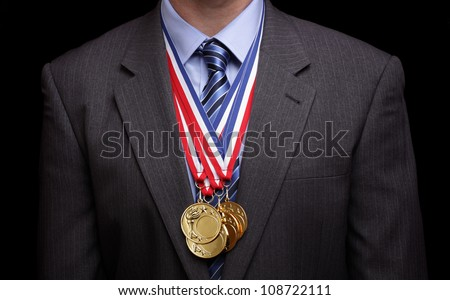 Gold medals hanging around a businessman neck concept for success and winning - stock photo