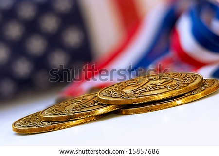 gold medals on an angle - stock photo