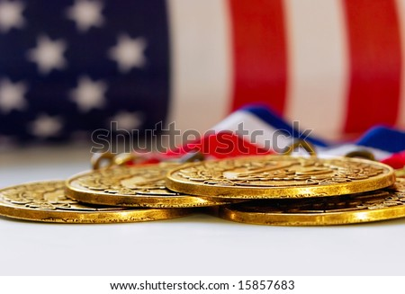 Gold medals with USA flag in background