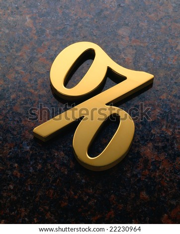 Gold metal percent symbol on granite background - stock photo