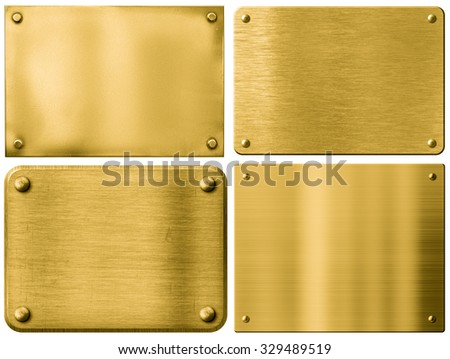 gold metal plates or signboards set with rivets isolated - stock photo