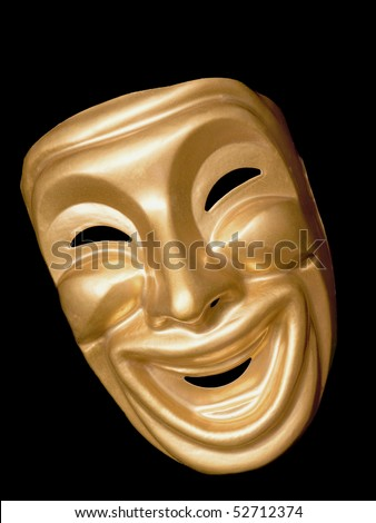Gold metallic traditional comedy mask on black - stock photo