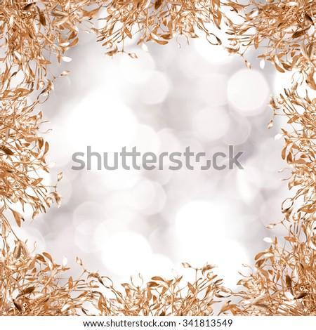 gold mistletoe on christmas background - stock photo