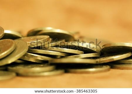 Gold money coins - savings, wealth, money concept - stock photo