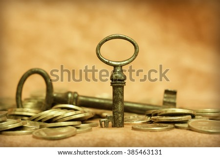 Gold money with an antique key - success and solution concept - stock photo