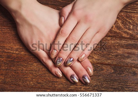 Gold Nail Art Tinsels On Wooden Stock Photo Royalty Free 556671337