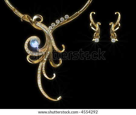 Gold necklace and earring with effect of a luminescence.modern jewels - stock photo