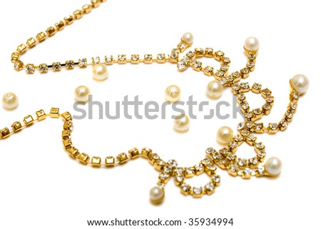 Gold necklace whith pearls isolated over white - stock photo
