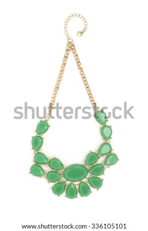 Gold necklace with green stones isolated on white