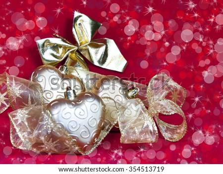 gold New Year's hearts and decorative ribbon - stock photo