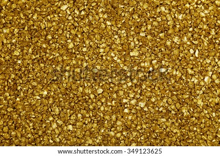 Gold nugget grains background, close-up - stock photo