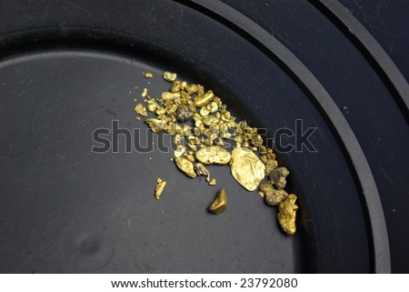 Gold nuggets, flakes and dust mined from the creeks and rivers of california - stock photo