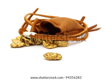 gold nuggets in a leather pouch - stock photo
