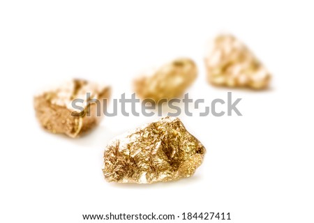 Gold nuggets isolated on white background.