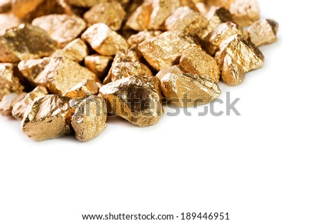 Gold nuggets isolated on white background. - stock photo