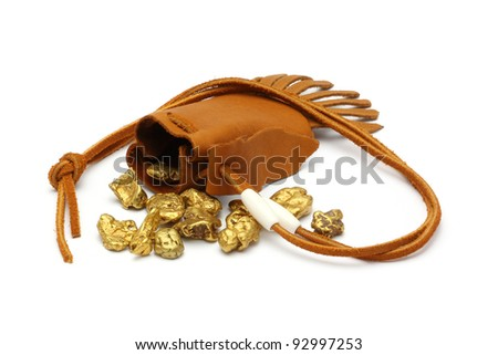 Gold nuggets leather pouch white background - stock photo