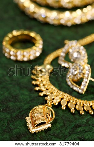 Gold ornaments on textured background. - stock photo