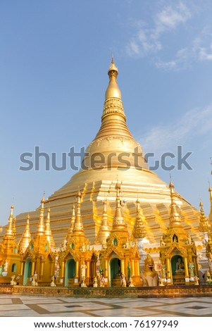 Gold Pagodas, Shrines, and Statues at the Buddhist Shwedagon Paya in Yangon, Myanmar ( Burma ) - stock photo