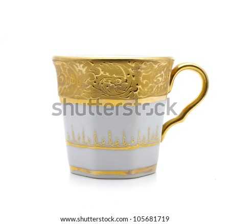 Gold paint white cup isolated on white background nice - stock photo
