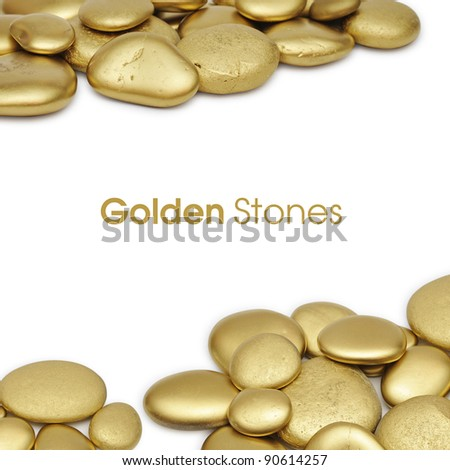 Gold painted stones over white background