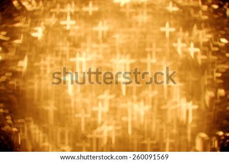 gold passion cross bokeh background - stock photo
