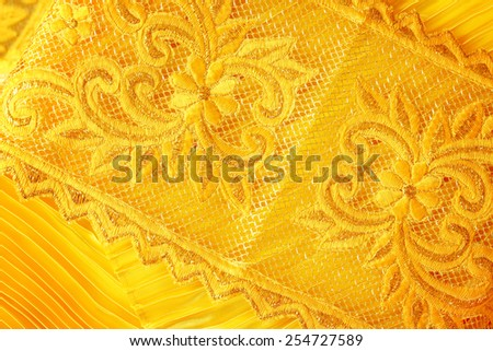 Gold peach lace sits on a gold background - stock photo