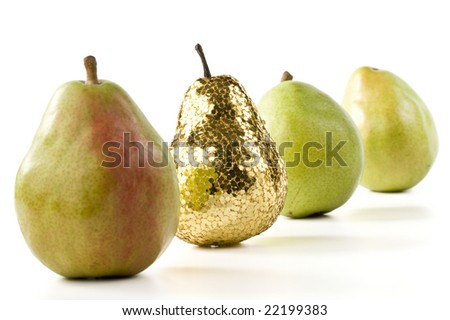 Gold pear among the usual. Concept for success.