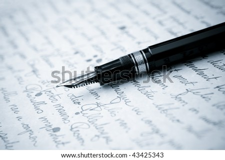 Gold Pen with Letter and Writing - stock photo