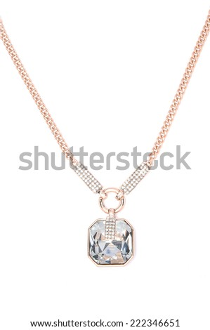 gold pendant with gem on a white background - stock photo