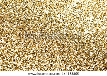Gold pieces of confetti. Up front view.  - stock photo