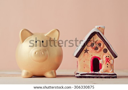 gold piggy and house model , saving plan