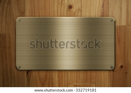 Gold plate texture on wood background