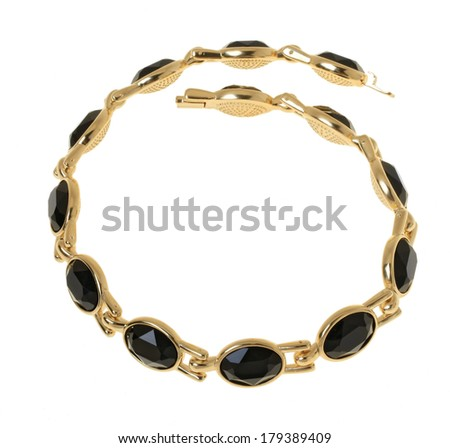 Gold plated necklace on a white background. Isolated - stock photo