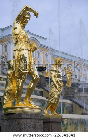 gold plated sculptures by fountains Grand cascade in the Lower Park in Pertergof, neighborhood of Saint-Petersburg, Russia - stock photo