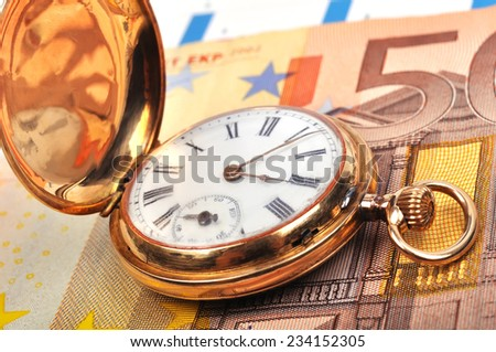 gold pocket watch and euro bills, close up - stock photo