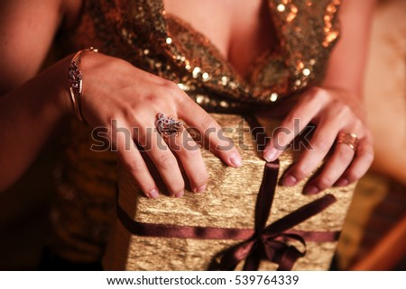 Gold present  in woman hand