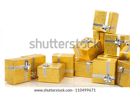 Gold presents on white background - stock photo