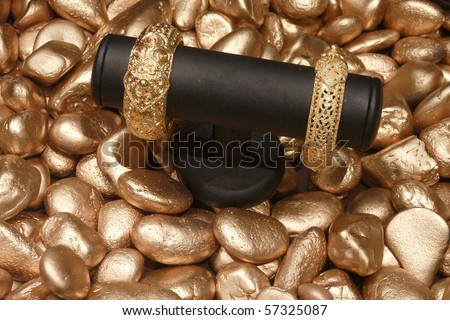 Gold product on golden stone - stock photo