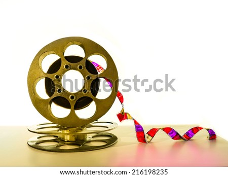 Gold reel of film on a white background - stock photo