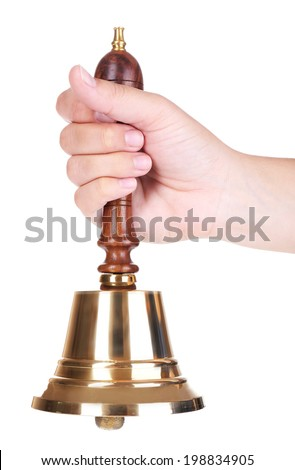 Gold retro school bell in hand isolated on white - stock photo