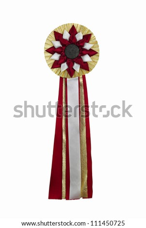Gold ribbon award. Rosette of golden, red and silver satin fabric with a ribbon tail isolated on white - stock photo