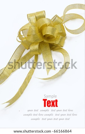 gold ribbon bow on white background with copy space - stock photo