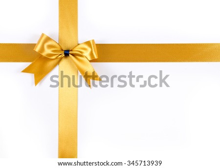 Gold ribbon with gold ribbon bow isolated on white
