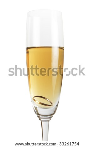 gold ring in wineglass with white wine close up