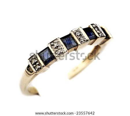 Gold ring with blue sapphires and diamonds