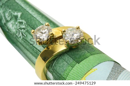 Gold ring with diamonds on hundred euro banknote. - stock photo